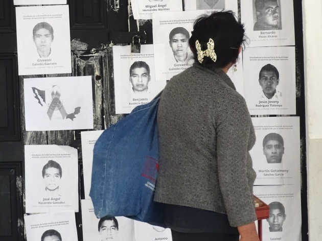 Woman_Walks_Past_Protest_Posters_for_Disappeared_43_Students_-_San_Cristobal_de_las_Casas_-_Chiapas_-_Mexico_(15042401753)